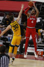 Ohio State's Duane Washington, right, shoots over Iowa's Connor McCaffery during the first half of an NCAA college basketball game Sunday, Feb. 28, 2021, in Columbus, Ohio. (AP Photo/Jay LaPrete)