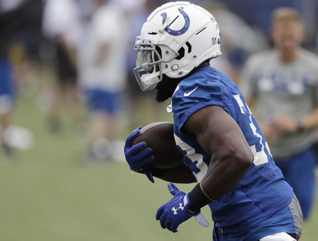 Indianapolis Colts' Robert Turbin runs a drill during practice at the NFL football team's training camp, Wednesday, June 13, 2018, in Indianapolis. (AP Photo/Darron Cummings)