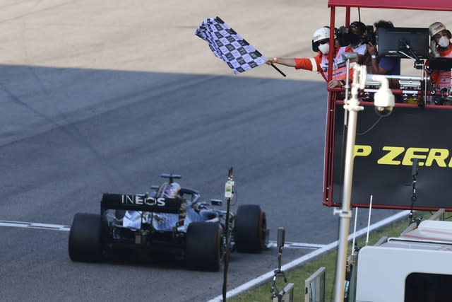 Lewis Hamilton takes the chequered flag at Sunday's Tuscan Grand Prix to move to within one win of Michael Schumacher's record and extend his lead in the standings
