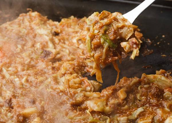 Monjayaki is pan-fried batter with a mix of meat and vegetable fillings.