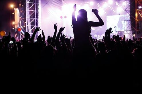"""<span class=""""caption"""">Nightclubs in Scotland will require vaccine certification for entry soon.</span> <span class=""""attribution""""><a class=""""link rapid-noclick-resp"""" href=""""https://www.shutterstock.com/image-photo/people-mass-event-concert-crowd-1928002484"""" rel=""""nofollow noopener"""" target=""""_blank"""" data-ylk=""""slk:Piotr Piatrouski/Shutterstock"""">Piotr Piatrouski/Shutterstock</a></span>"""
