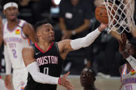 Houston Rockets' Russell Westbrook (0) goes up for a shot as Oklahoma City Thunder's Nerlens Noel, right, defends during the second half of an NBA first-round playoff basketball game in Lake Buena Vista, Fla., Wednesday, Sept. 2, 2020. (AP Photo/Mark J. Terrill)
