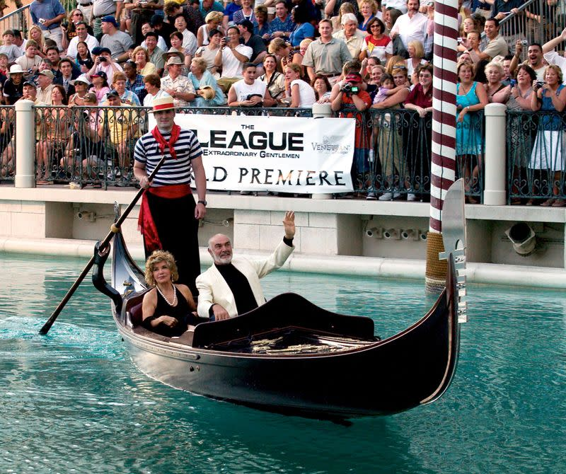 FILE PHOTO: Actor Sean Connery and his wife Micheline arrive by gondola at the Venetian Resort Hotel & Casino in Las Vegas