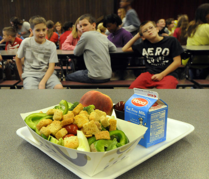 A select healthy chicken salad food item from the lunch line of the cafeteria at Draper Middle School in Rotterdam, N.Y., Tuesday, Sept. 11, 2012. The leaner, greener school lunches served under new federal standards are getting mixed grades from students. (AP Photo/Hans Pennink)