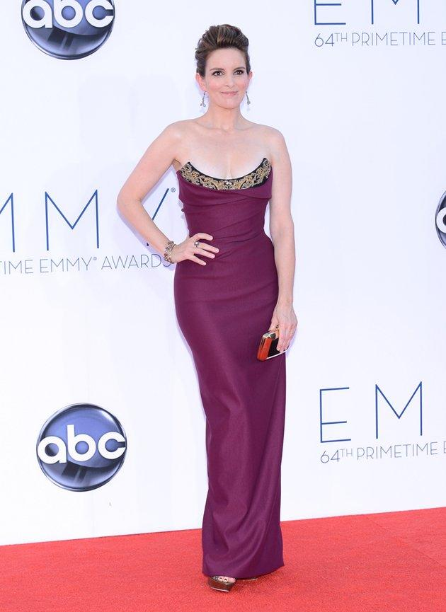 "While there wasn't necessarily anything wrong with ""30 Rock"" star Tina Fey's Emmys look, she kind of looks the same at every red carpet event. Updo? Check. Basic makeup? Check. Nomination for outstanding lead actress in a comedy series for ""30 Rock""? Check. (OK, that one's not her fault.) And her Vivienne Westwood strapless dress, with its embellished droopy neckline, didn't really wow us either.."