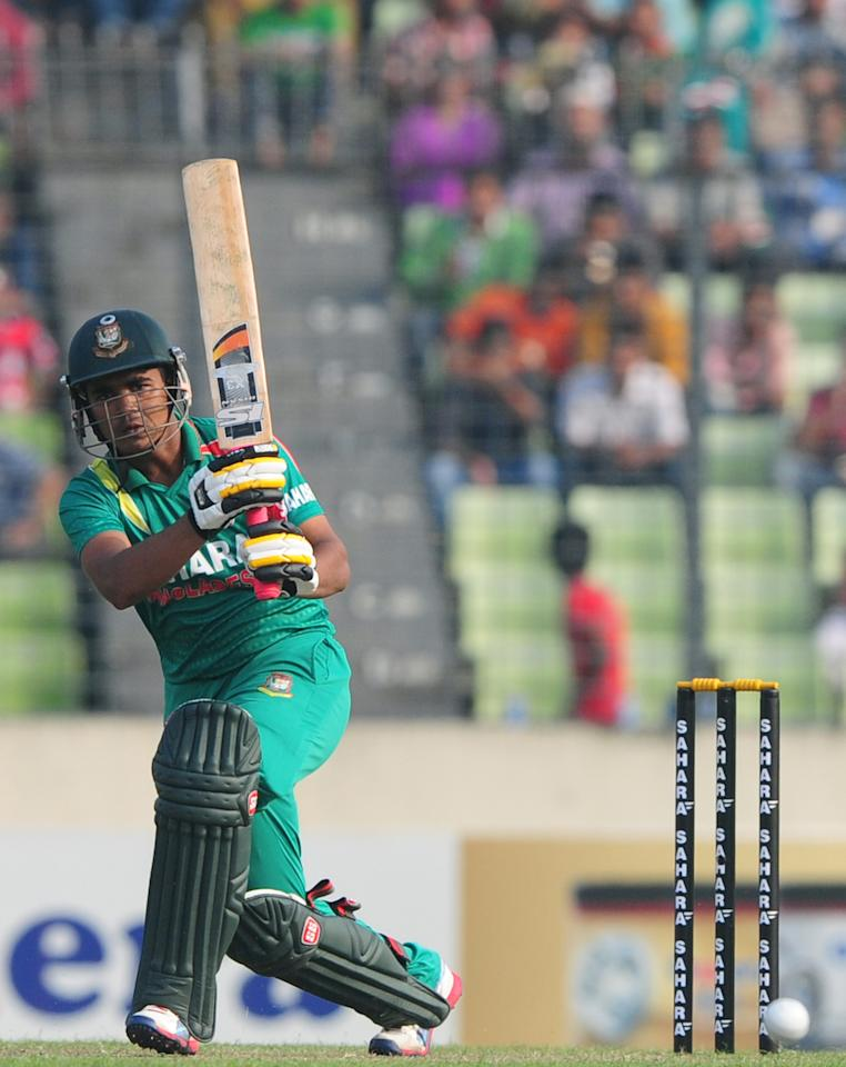 Bangladesh batsman Shamsur Rahman plays a shot during the T20 cricket match between Bangladesh and New Zealand at the Sher-e-Bangla National Cricket Stadium in Dhaka on November 6, 2013. AFP PHOTO/ Munir uz ZAMAN        (Photo credit should read MUNIR UZ ZAMAN/AFP/Getty Images)