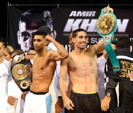 Amir Khan (L) will defend the WBA title he was given earlier this week while Danny Garcia defends his WBC crown