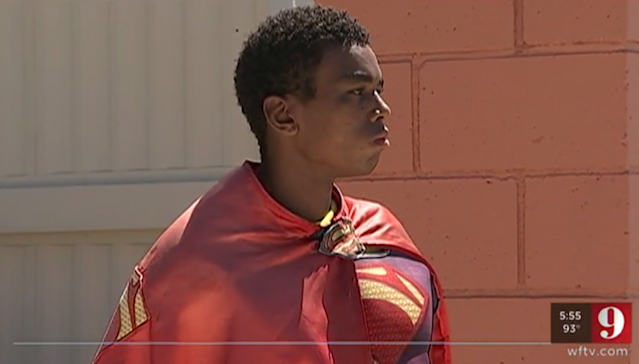 Rae Pitt, 20, poses as Superman and waves to the community in Minneola, Fla. Pitt was attacked last week by a 26-year-old man. (Photo: WFTV)