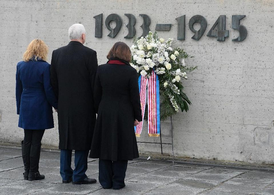 US Vice President Michael Richard Pence (C), his wife Karen Pence (R) and his daughter Charlotte Pence stand at the International Memorial of former Nazi concentration camp of Dachau on February 19, 2017 (AFP Photo/Thomas Kienzle )