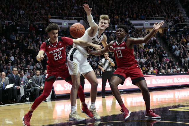 Purdue center Matt Haarms, center, battles for a rebound with Rutgers Caleb McConnell (22) and Shaq Carter (13) during the second half of an NCAA college basketball game in West Lafayette, Ind., Tuesday, Jan. 15, 2019. Purdue won 89-54. (AP Photo/AJ Mast)