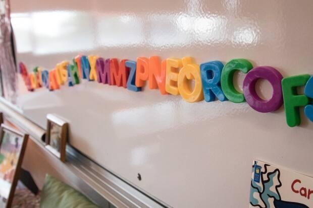 Magnetic letters are stuck on a white board in a classroom. The $605-million agreement signed between the province and Ottawa could be affected by the outcome of the federal election. (Robert Short/CBC - image credit)
