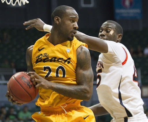 Long Beach State forward T.J. Robinson (20) grabs a rebound away from Auburn forward Adrian Forbes (45) in the first half of an NCAA college basketball game Friday, Dec. 23, 2011, in Honolulu. (AP Photo/Eugene Tanner)