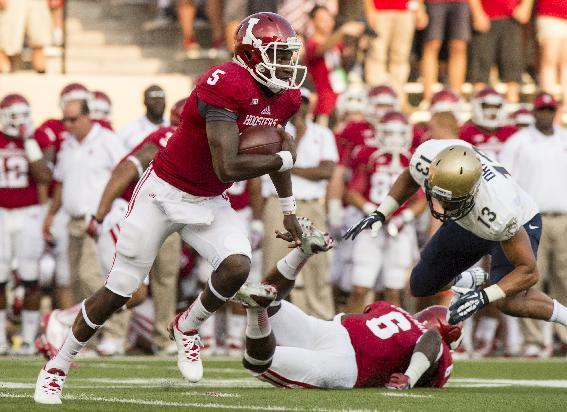Indiana quarterback Tre Roberson (5) runs the ball out of the backfield against Navy during the first half of an NCAA college football game, Saturday, Sept. 7, 2013, in Bloomington, Ind. (AP Photo/Doug McSchooler)