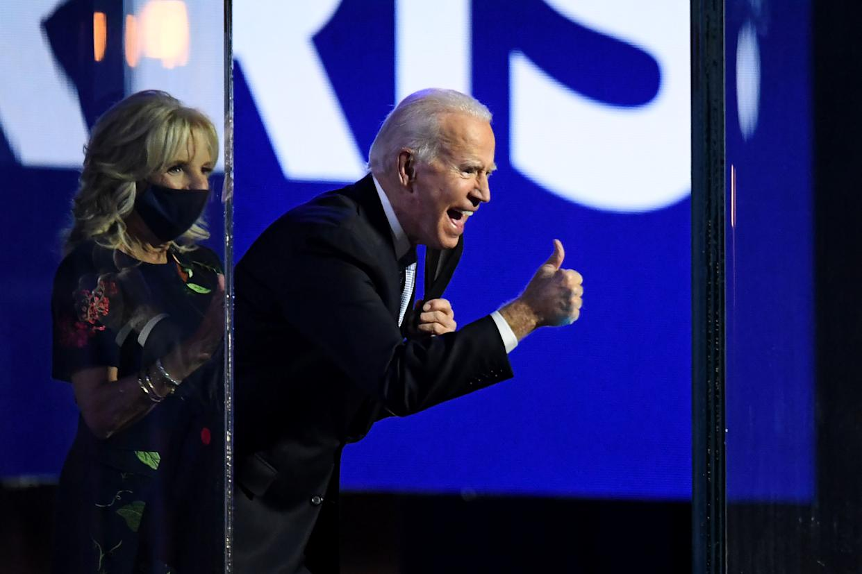 US President-elect Joe Biden with his wife Jill Biden, gives a thumbs up on stage after delivering remarks in Wilmington, Delaware, on November 7, 2020, and being declared the winner of the US presidential election. (Photo by Roberto SCHMIDT / AFP) (Photo by ROBERTO SCHMIDT/AFP via Getty Images)