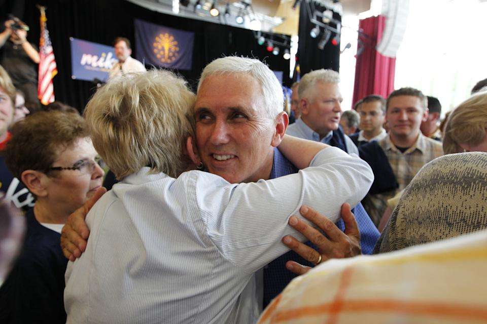 Then-Rep. Mike Pence hugs one of many supporters at a 2011 event in Columbus, Ind., to kick off his gubernatorial run.