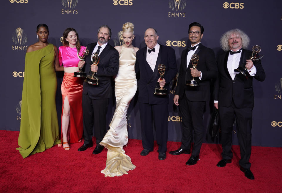"""Moses Ingram, from left, Marielle Heller, Scott Frank, Anya Taylor-Joy, William Horberg, Mick Aniceto and Marcus Loges, winners of the award for outstanding directing for a limited or anthology series or movie for """"The Queen's Gambit"""", pose at the 73rd Primetime Emmy Awards on Sunday, Sept. 19, 2021, at L.A. Live in Los Angeles. (AP Photo/Chris Pizzello)"""