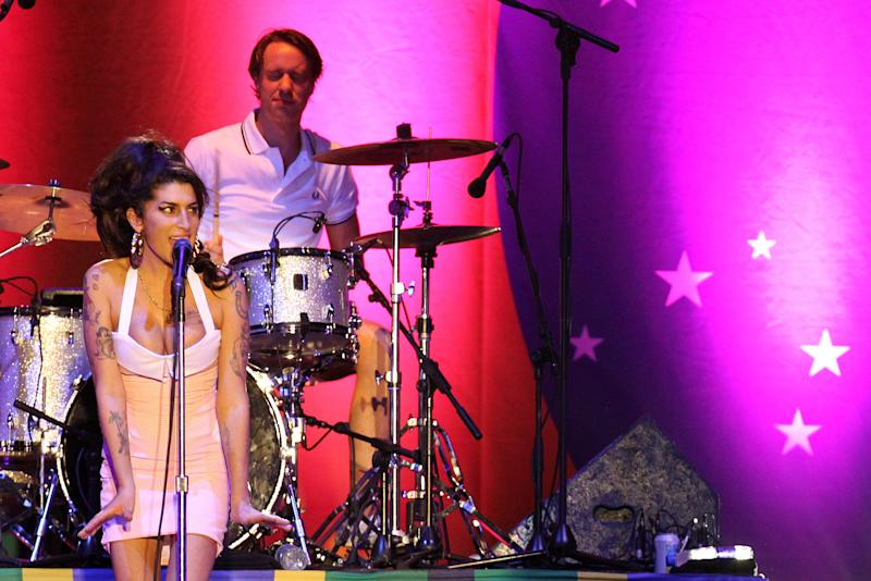 FILE- In this Jan. 8, 2011 file photo, British artist Amy Winehouse, left, performs during her show in Florianopolis, Brazil. Winehouse died one year ago on July 23, 2011 at her London home from accidental alcohol poisoning at age 27.  (AP Photo/Nabor Goulart, File)