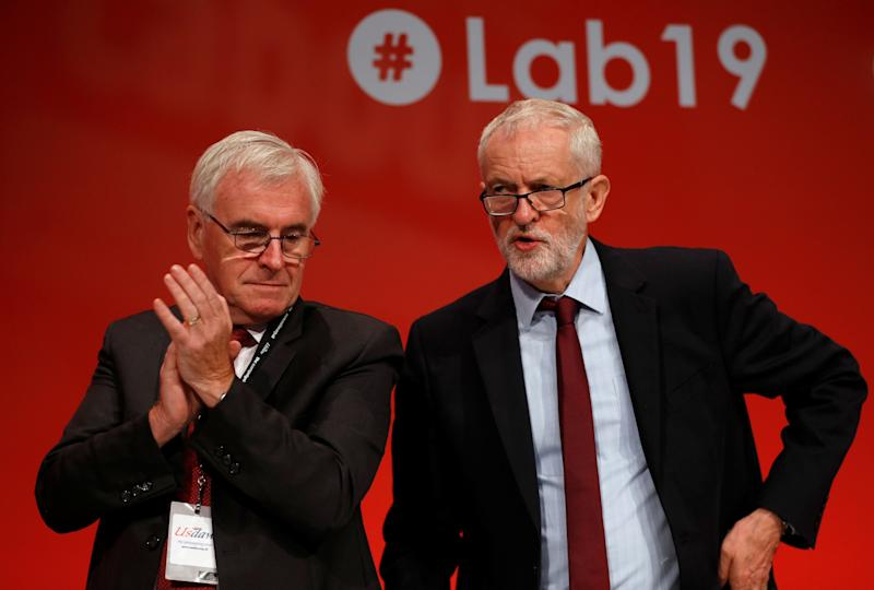 British Labour MP John McDonnell applauds next to Labour Party leader Jeremy Corbyn at the Labour party annual conference in Brighton, Britain September 24, 2019. REUTERS/Peter Nicholls