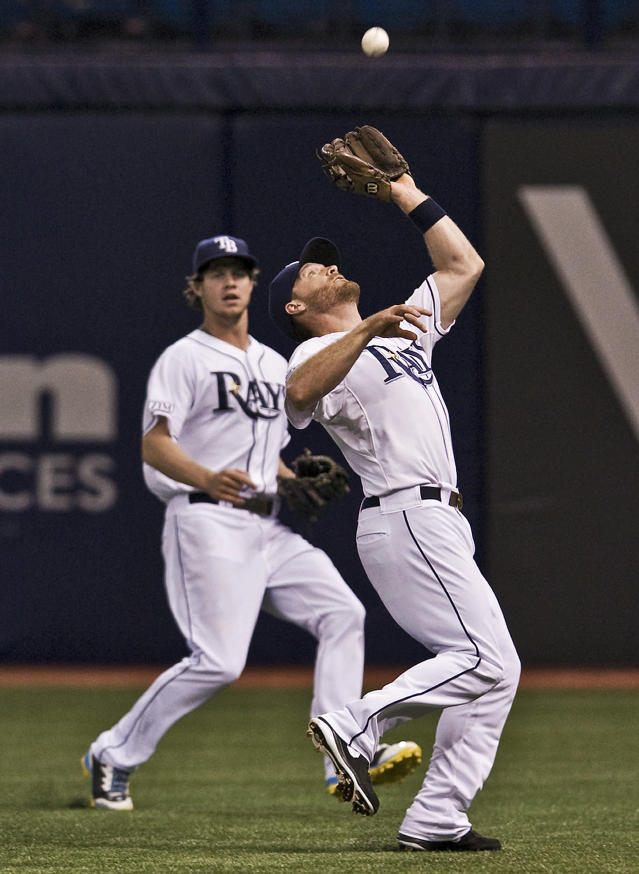 Tampa Bay Rays left fielder Wil Myers, left, backs up second baseman Logan Forsythe, right, who catches a fly ball hit by Toronto Blue Jays' Jose Reyes during the first inning of a baseball game Thursday, Sept. 4, 2014, in St. Petersburg, Fla. (AP Photo/Steve Nesius)