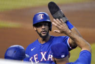Texas Rangers' Leody Taveras celebrates after scoring on a ground out hit by teammate Isiah Kiner-Falefa during the first inning of a baseball game against the Arizona Diamondbacks, Wednesday, Sept. 23, 2020, in Phoenix. (AP Photo/Matt York)