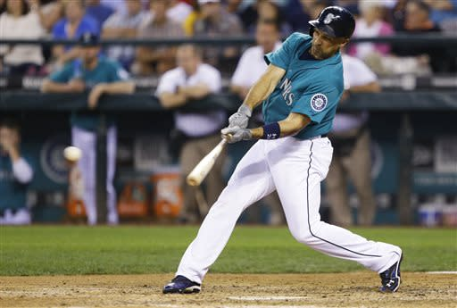 Seattle Mariners' Raul Ibanez hits an RBI single in the sixth inning of a baseball game against the Boston Red Sox, Monday, July 8, 2013, in Seattle. (AP Photo/Ted S. Warren)