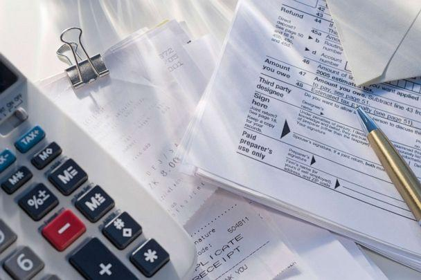 PHOTO: Tax return paper work sits next to a calculator in an undated stock image. (Tetra Images/STOCK IMAGE/Tetra Images/Getty Images)