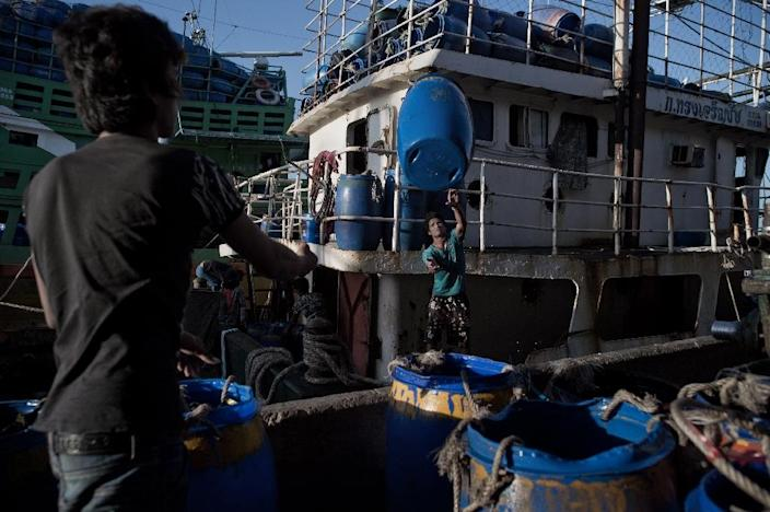Migrant workers at work in a port in Mahachai, on the outskirts of Bangkok (AFP Photo/Nicolas Asfouri)