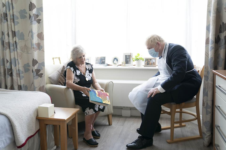 Prime Minister Boris Johnson talks to resident Kathleen during a visit to Westport Care Home in Stepney Green, east London, ahead of unveiling his long-awaited plan to fix the broken social care system. Picture date: Tuesday September 7, 2021.