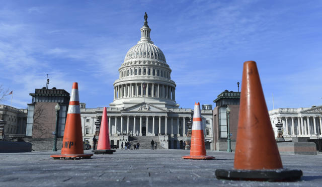 Construction cones used to cover walkway flaws, stand along the sidewalk on Capitol Hill in Washington D.C., on Jan. 19, 2018. On the edge of a government shutdown, a divided House voted late Thursday to keep the government open past a Friday deadline — setting up an eleventh-hour standoff in the Senate, where Democrats have vowed to kill the measure. (Photo: Susan Walsh/AP)