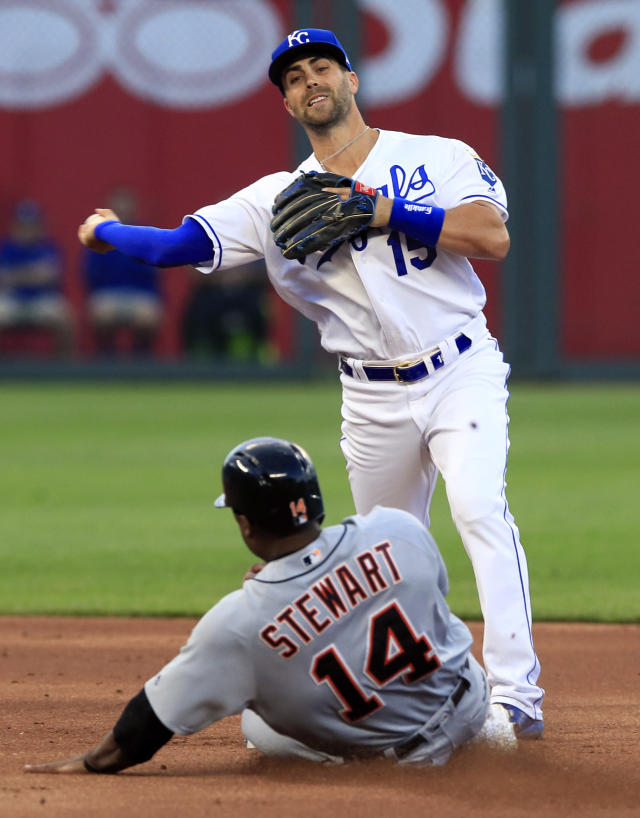 Kansas City Royals second baseman Whit Merrifield (15) forces out Detroit Tigers' Christin Stewart (14) and throws to first during the first inning of a baseball game at Kauffman Stadium in Kansas City, Mo., Wednesday, June 12, 2019. Nicholas Castellanos was safe at first. (AP Photo/Orlin Wagner)