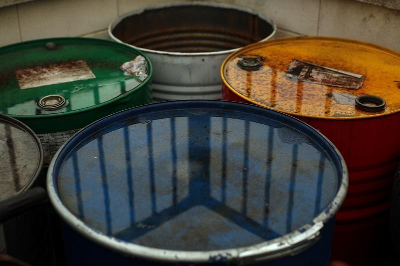 Used oil barrels are seen outside a garage in Cuevas del Becerro