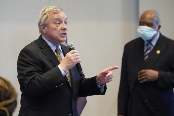 Sen. Dick Durbin, D-Ill., speaks as Rep. Danny Davis, D-Ill., listens during a visit with Vice President Kamala Harris to a COVID-19 vaccination site Tuesday, April 6, 2021, in Chicago. The site is a partnership between the City of Chicago and the Chicago Federation of Labor. (AP Photo/Jacquelyn Martin)
