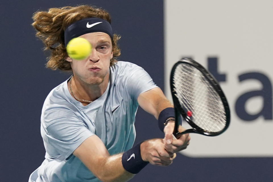 Andrey Rublev, of Russia, returns a shot from Sebastian Korda, of the United States, during the Miami Open tennis tournament Thursday, April 1, 2021, in Miami Gardens, Fla. (AP Photo/Wilfredo Lee)