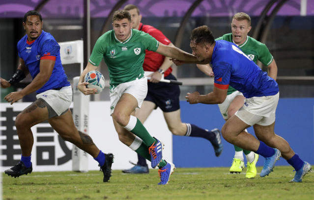 Ireland's Jordan Larmour runs past the Samoan defence during the Rugby World Cup Pool A game at Fukuoka Hakatanomori Stadium between Ireland and Samoa, in Fukuoka, Japan, Saturday, Oct. 12, 2019. (AP Photo/Aaron Favila)
