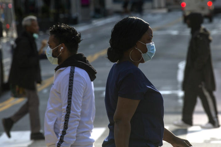 People wearing face masks on 33rd Street in New York City on Monday. (Kena Betancur/Getty Images)