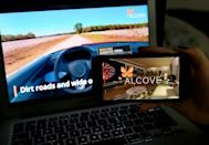 This illustration picture shows a virtual road trip on a computer and the travel application logo from Alcove, a platform for virtual reality travel which has gained momentum during the pandemic