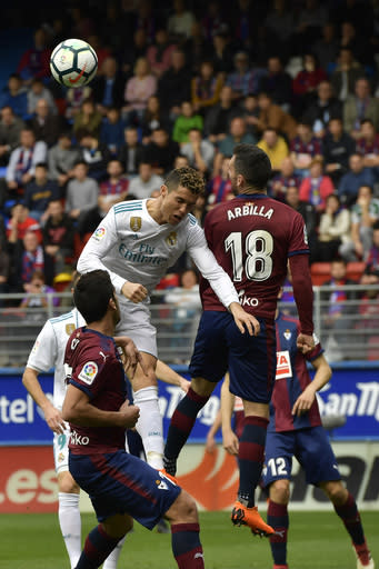 Real Madrid's Cristiano Ronaldo heads the ball during the Spanish La Liga soccer match between Real Madrid and SD Eibar at Ipurua stadium, in Eibar, northern Spain, Saturday, March10, 2018. Real Madrid won the match 2-1. (AP Photo/Alvaro Barrientos)