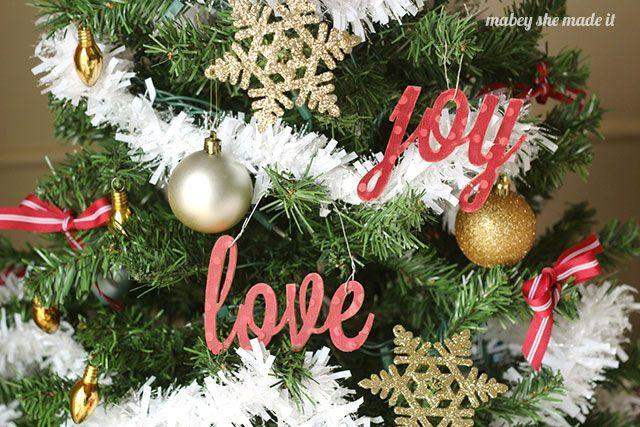 """<p>Spread cheer this holiday season with these pretty pieces you can use as ornaments or <a href=""""https://www.countryliving.com/diy-crafts/tips/g907/craft-ideas-for-christmas-decorations-1209/"""" rel=""""nofollow noopener"""" target=""""_blank"""" data-ylk=""""slk:festive signage"""" class=""""link rapid-noclick-resp"""">festive signage</a>. </p><p><strong>Get the tutorial at <a href=""""http://www.mabeyshemadeit.com/peace-love-and-joy-ornaments/"""" rel=""""nofollow noopener"""" target=""""_blank"""" data-ylk=""""slk:Mabey She Made It"""" class=""""link rapid-noclick-resp"""">Mabey She Made It</a>.</strong></p><p><a class=""""link rapid-noclick-resp"""" href=""""https://www.amazon.com/Pattern-Paper-Pack-Single-Sided-Collection/dp/B07B4KV7V4/?tag=syn-yahoo-20&ascsubtag=%5Bartid%7C10050.g.1070%5Bsrc%7Cyahoo-us"""" rel=""""nofollow noopener"""" target=""""_blank"""" data-ylk=""""slk:SHOP FESTIVE CARD STOCK"""">SHOP FESTIVE CARD STOCK</a></p>"""