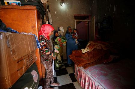 Amany Shamekh (L), 16, stands near her mother Zeinab (R) with Reem Mamdouh (C), 26, wife of Amany's brother at their home in Awlad Serag village of Assiut Governorate, south of Cairo, Egypt, February 8, 2018. REUTERS/Hayam Adel/Files