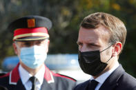French President Emmanuel Macron arrives at the 'Centre de cooperation policiere et douaniere' (Franco-Spanish Police and Customs Cooperation Center) during a visit on the strengthening border controls at the crossing between Spain and France, at Le Perthus, France, Thursday, Nov. 5, 2020. (Guillaume Horcajuelo, Pool via AP)