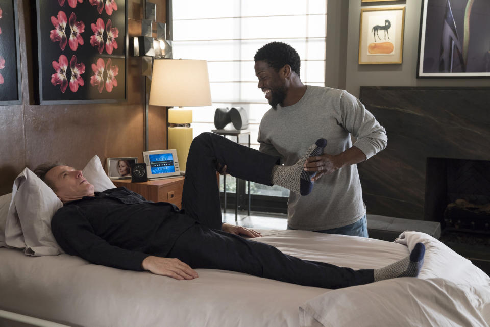 """Bryan Cranston, left, and Kevin Hart in a scene from """"The Upside."""" (David Lee/STXfilms via AP)"""