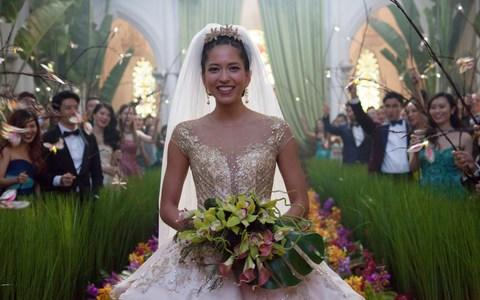 "This image released by Warner Bros. Entertainment shows Sonoya Mizuno in a scene from the film ""Crazy Rich Asians."""