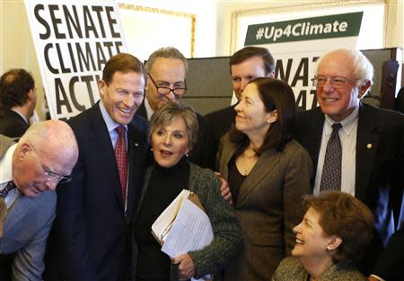 U.S. Senators from the Senate Climate Action Task Force gather before holding the Senate floor to urge action on climate change, on Capitol Hill in Washington March 10, 2014. REUTERS/Yuri Gripas