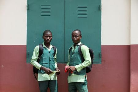 Non-identical twins Afeez and Lateef Azeez pose in Igbo Ora town, Oyo State, Nigeria April 3, 2019. Picture taken April 3, 2019. REUTERS/Afolabi Sotunde