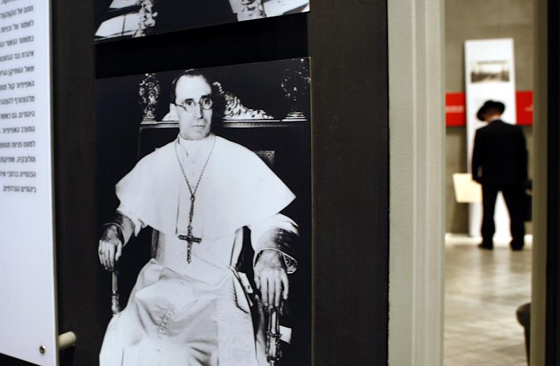 FILE - In this Saturday, April 12, 2007 file photo, part of a display wartime Pope Pius XII is seen in the museum at the Yad Vashem Holocaust Memorial in Jerusalem. Israel's national Holocaust memorial has toned down its account of Pope Pius XII's controversial conduct during World War II, following a diplomatic flap with the Vatican. A wall panel at the Yad Vashem memorial inaugurated Sunday, July 1, 2012 still says the wartime pontiff did not do enough on behalf of Europe's Jews. (AP Photo/Kevin Frayer, File)