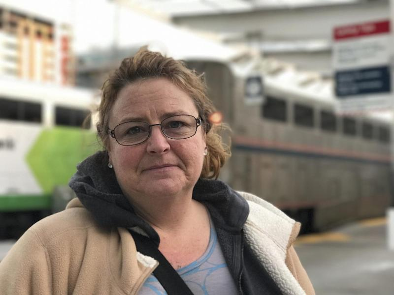 In this photo taken Wednesday, Jan. 25, 2017, in Denver, Machelle Lowe, 45, of Mount Pleasant Iowa, was traveling to see her daughter in Wyoming after discovering she has cancer. AP Tampa correspondent Tamara Lush spent 15 days traveling via train across the U.S. as part of Amtrak's residency program, designed for creative professionals to spend time writing on the rails. She spoke with dozens of people _ fellow travelers, friends and family waiting for loved one at stations, train workers _ and filed occasional dispatches for the Tales on a Train project. (AP Photo/Tamara Lush)