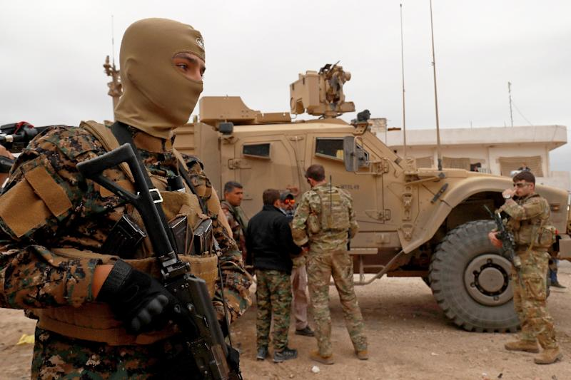 US forces patrol the Kurdish-held Syrian town of Al-Darbasiyah on the Turkish border on November 4, 2018, part of a deployment intended to deter a Turkish attack that the Kurds fear may go ahead after Washington's announcement last month of a pullout (AFP Photo/Delil SOULEIMAN)