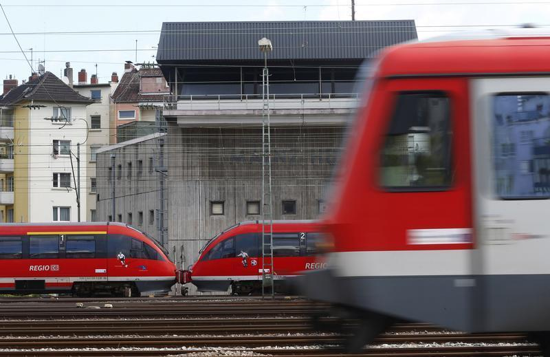 Trains drive past the signal tower of the Deutsche Bahn at the main train station in Mainz