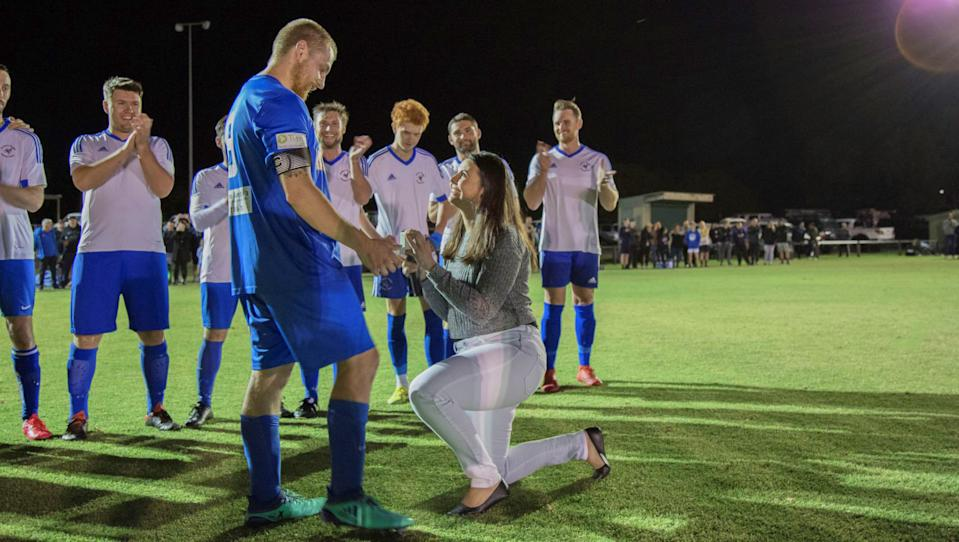 Jasmine popped the question in the middle of the game. Photo: Dominos