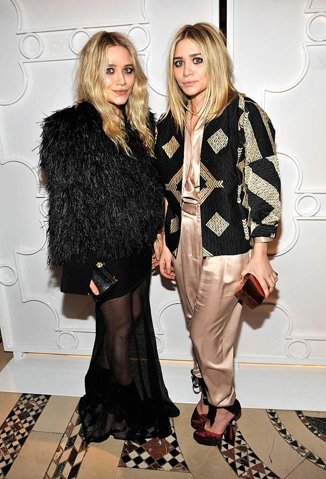 """Mary-Kate Olsen (who appears to be wearing a Yeti) and her sister Ashley (whose satin jumpsuit could use a steam) flustered us yet again upon arriving at an A-list event in atrocious outfits. Will the 23-year-old former """"Full House"""" cuties ever get a clue, a stylist, or a mirror? Probably not. Kevin Mazur/<a href=""""http://www.wireimage.com"""" target=""""new"""">WireImage.com</a> - February 10, 2010"""